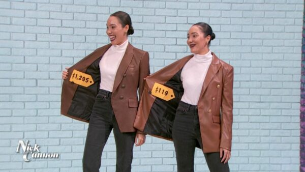 twin girls in brown jackes